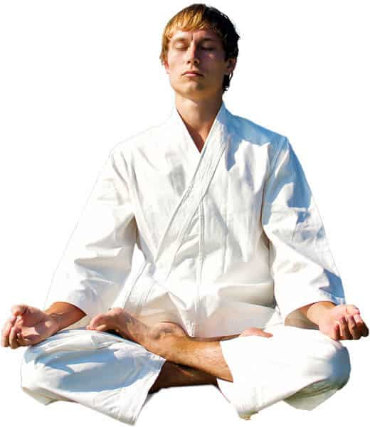 Martial Arts Lessons for Adults in Bayonne NJ - Young Man Thinking and Meditating in White