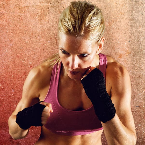 Mixed Martial Arts Lessons for Adults in Bayonne NJ - Lady Kickboxing Focused Background