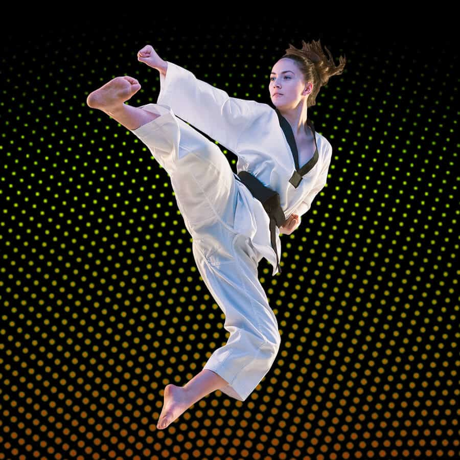 Martial Arts Lessons for Adults in Bayonne NJ - Girl Black Belt Jumping High Kick