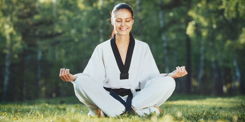Martial Arts Lessons for Adults in Bayonne NJ - Happy Woman Meditated Sitting Background